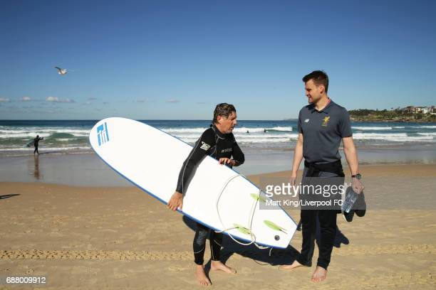 Simon Mignolet of Liverpool FC interacts with a surfer during a Liverpool FC Fan Day at Bondi Beach on May 25 2017 in Sydney Australia