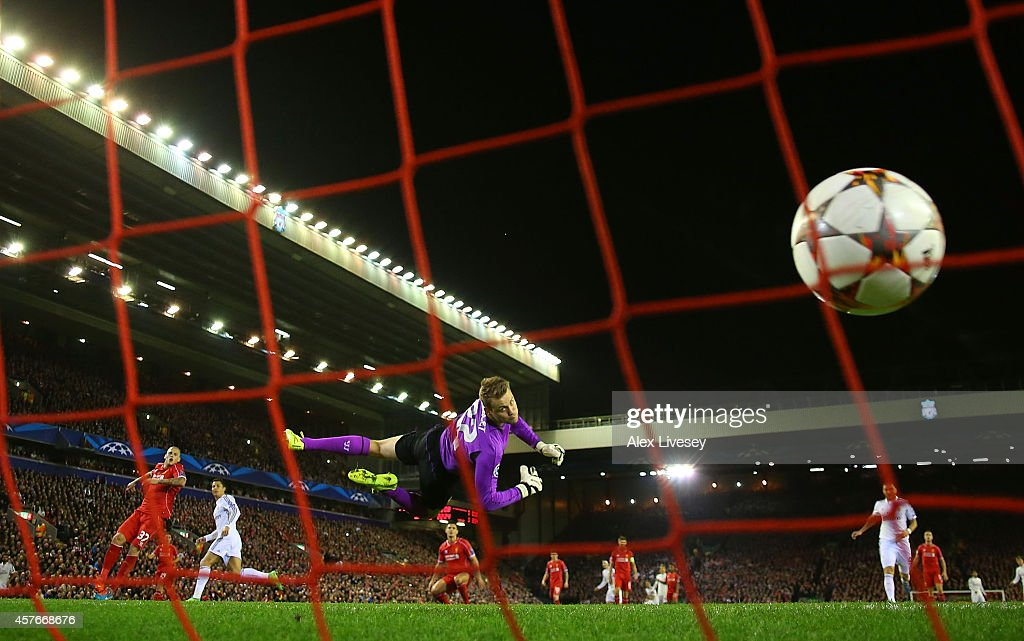 Simon Mignolet of Liverpool is unable to stop Cristiano Ronaldo of Real Madrid scoring the opening goal during the UEFA Champions League Group B match between Liverpool and Real Madrid CF on October 22, 2014 in Liverpool, United Kingdom.