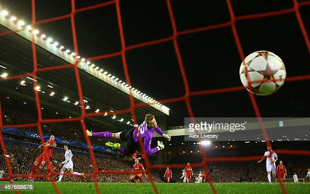 Simon Mignolet of Liverpool is unable to stop Cristiano Ronaldo of Real Madrid scoring the opening goal during the UEFA Champions League Group B...