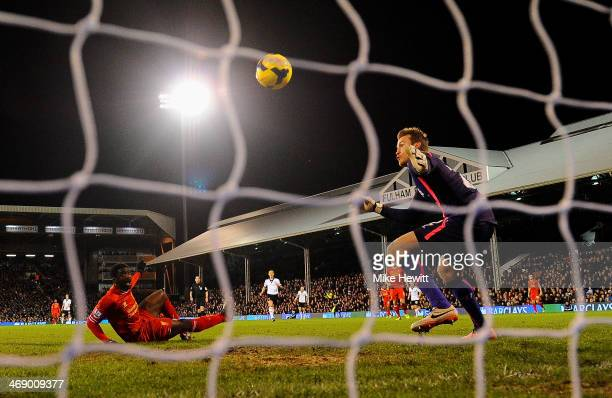 Simon Mignolet of Liverpool looks on as Kolo Toure of Liverpool scores an own goal during the Barclays Premier League match between Fulham and...