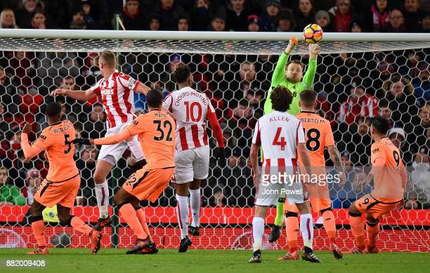 Simon Mignolet of Liverpool makes a save during the Premier League match between Stoke City and Liverpool at Bet365 Stadium on November 29 2017 in...