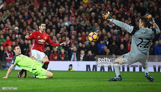 Simon Mignolet of Liverpool makes a save from Henrikh Mkhitaryan of Manchester United as James Milner of Liverpool challenges during the Premier...