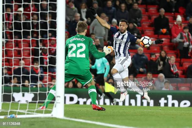 Simon Mignolet of Liverpool makes palm save from Matt Phillips of West Bromwich Albion during the The Emirates FA Cup Fourth Round match between...
