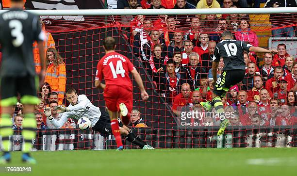 Simon Mignolet of Liverpool saves a penalty from Jonathan Walters of Stoke City during the Barclays Premier League match between Liverpool and Stoke...