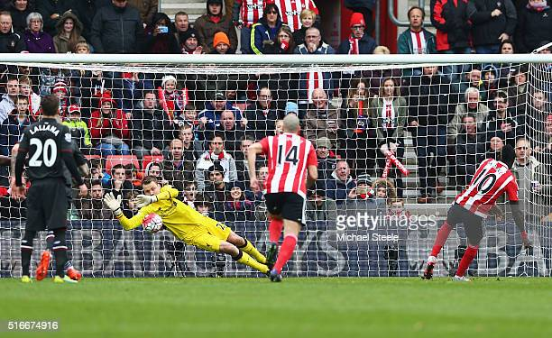 Simon Mignolet of Liverpool saves a penalty from Sadio Mane of Southampton during the Barclays Premier League match between Southampton and Liverpool...