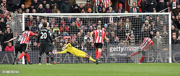 Simon Mignolet of Liverpool saves a penalty taken by Sadio Mane of Southampton during the Barclays Premier League match between Southampton and...