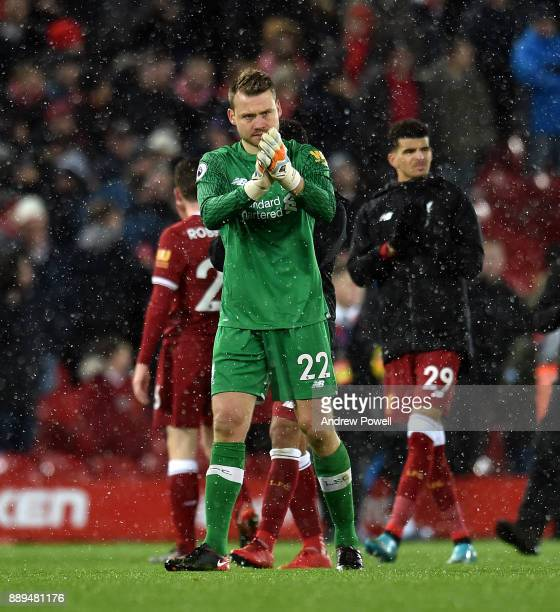 Simon Mignolet of Liverpool shows his appreciation to the fans at the end of the Premier League match between Liverpool and Everton at Anfield on...