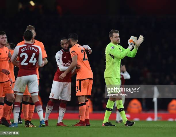 Simon Mignolet of Liverpool shows his appreciation to the fans at the end of the Premier League match between Arsenal and Liverpool at Emirates...