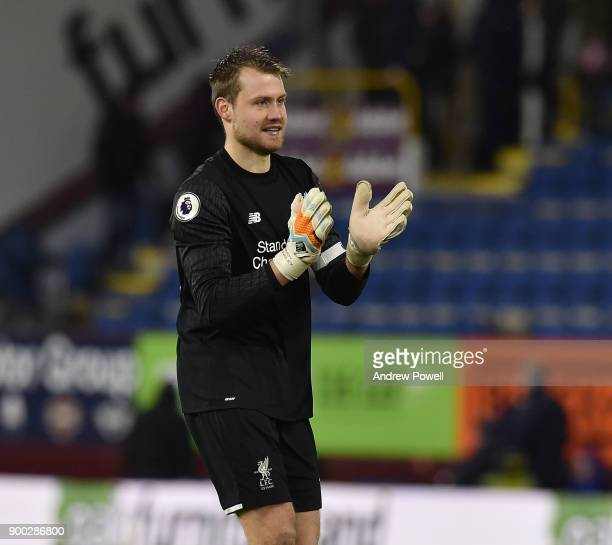 Simon Mignolet of Liverpool shows his appreciation to the fans at the end of the Premier League match between Burnley and Liverpool at Turf Moor on...