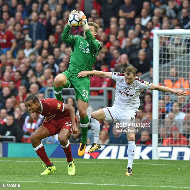 Simon Mignolet of Liverpool with Ashley Barnes of Burnley during the Premier League match between Liverpool and Burnley at Anfield on September 16...