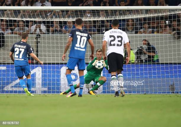 Simon Mignolet saves a penalty shot by Andrej Kramaric of Hoffenheim during the UEFA Champions League Qualifying PlayOffs Round First Leg match...