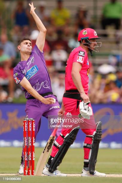 Simon Milenko of the Hobart Hurricanes bowls during the Big Bash League match between the Hobart Hurricanes and the Sydney Sixers at Traeger Park on...