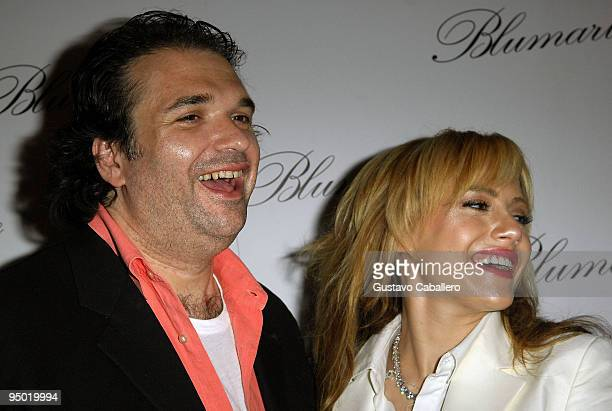 Simon Monjack and Brittany Murphy pose at the opening of the flagship store in the United States at the Village of Merrick Park on April 2, 2008 in...