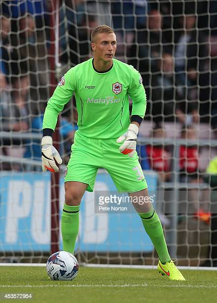 Simon Moore of Cardiff City in action during the Capital One Cup First Round match between Coventry City and Cardiff City at Sixfields Stadium on...