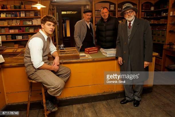Simon Morzé Johannes Krisch Nikolaus Leytner and Bruno Ganz pose during a set visit of the film production 'Der Trafikant' at Bavaria Studios on...