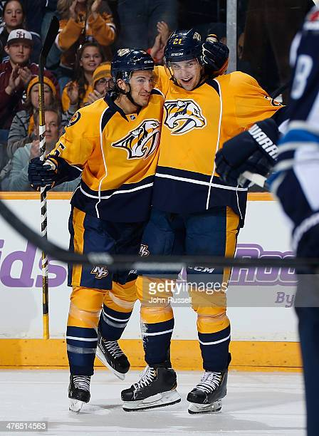 Simon Moser celebrates his first NHL goal with Michael Del Zotto of the Nashville Predators against the Winnipeg Jets at Bridgestone Arena on March 1...