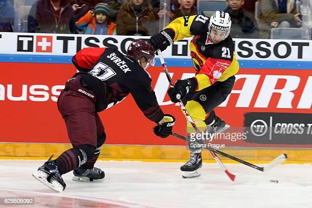 Simon Moser of Bern challenges Jan Svrcek of HC Sparta Prague during the Champions Hockey League Quarter Final match between Sparta Prague and SC...