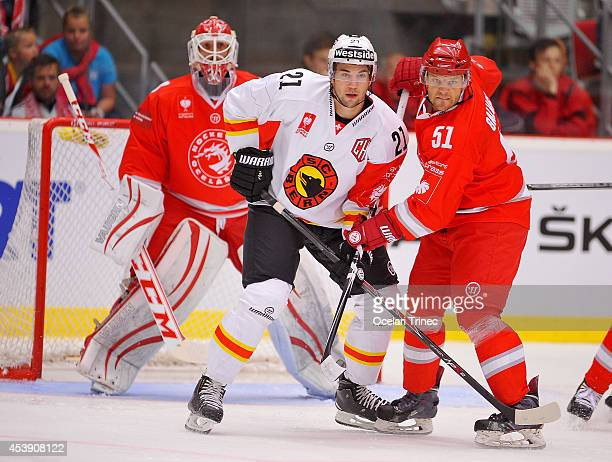Simon Moser of SC Bern and Lukas Galvas of HC Ocelari Trinec tangle during the Champions Hockey League group stage game between HC Ocelari Trinec and...