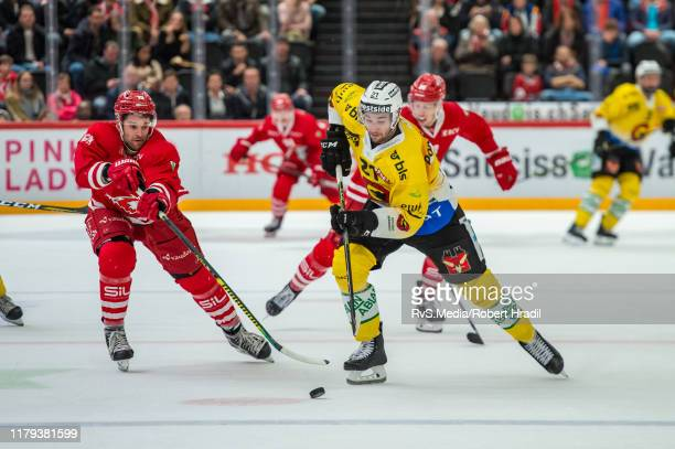 Simon Moser of SC Bern battles for the puck with Dustin Jeffrey of Lausanne HC during the Swiss National League game between Lausanne HC and SC Bern...
