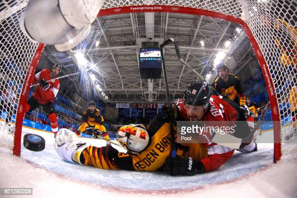 Simon Moser of Switzerland celebrates after scoring in the second period against Germany during the Men's Ice Hockey Qualification Playoff game on...