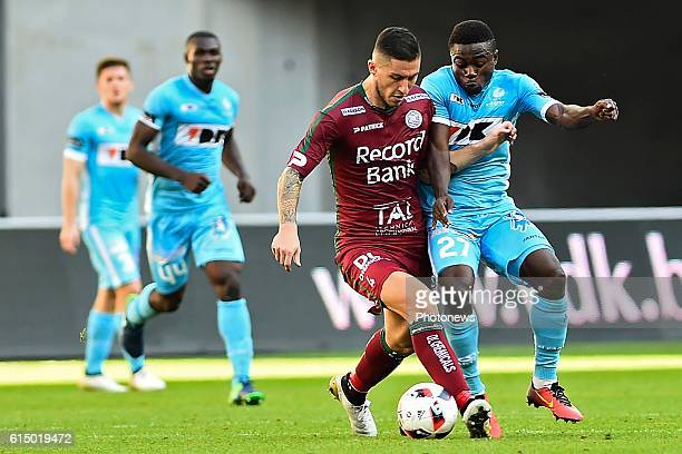 Simon Moses forward of KAA Gent and Luca Marrone midfielder of SV Zulte Waregem pictured during the Jupiler Pro League match between KAA Gent and SV...