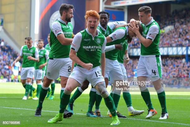 Simon Murray and fellow Hibernian plays celebrate their third goal during the Ladbrokes Scottish Premiership match between Rangers and Hibernian at...