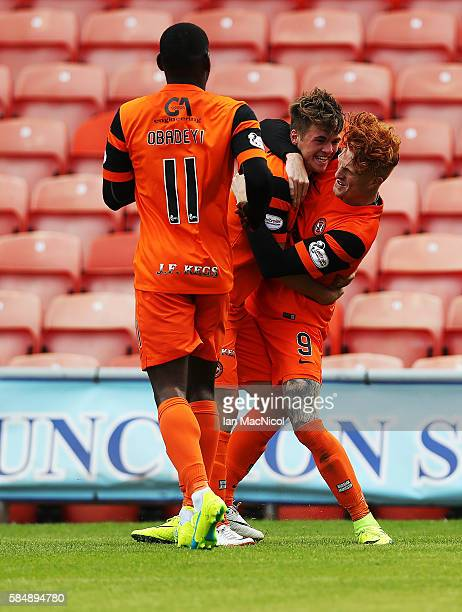 Simon Murray of Dundee United is congratulated after he scores the opening goal during the Betfred League Cup group match between Dundee United and...