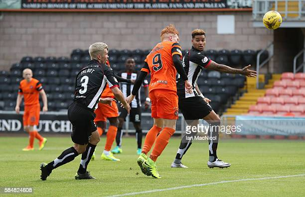 Simon Murray of Dundee United scores the opening goal during the Betfred League Cup group match between Dundee United and Dunfermline Athletic at...