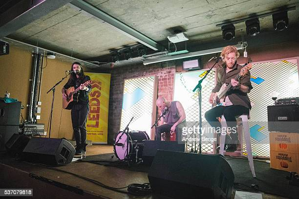 Simon Neil Ben Johnston and James Johnston of Biffy Clyro perform on stage for Leeds Festival competition winners at Headrow House on June 1 2016 in...