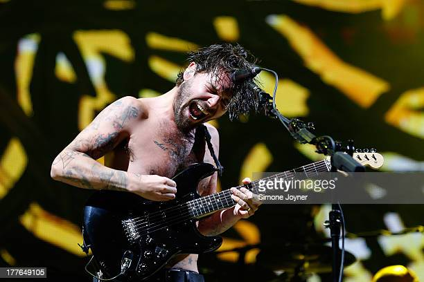 Simon Neil of Biffy Clyro performs live on the main stage during day three of Reading Festival at Richfield Avenue on August 25 2013 in Reading...