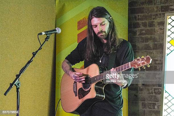 Simon Neil of Biffy Clyro performs on stage for Leeds Festival competition winners at Headrow House on June 1 2016 in Leeds England
