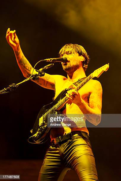 Simon Neil of Biffy Clyro performs on stage on Day 1 of Leeds Festival 2013 at Bramham Park on August 23, 2013 in Leeds, England.