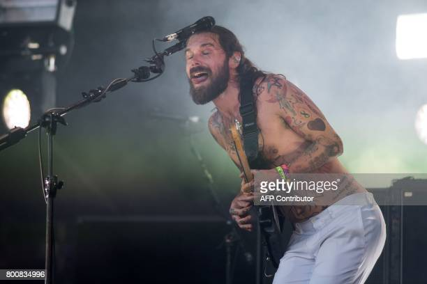 Simon Neil of Biffy Clyro performs on the Pyramid Stage at the Glastonbury Festival of Music and Performing Arts on Worthy Farm near the village of...