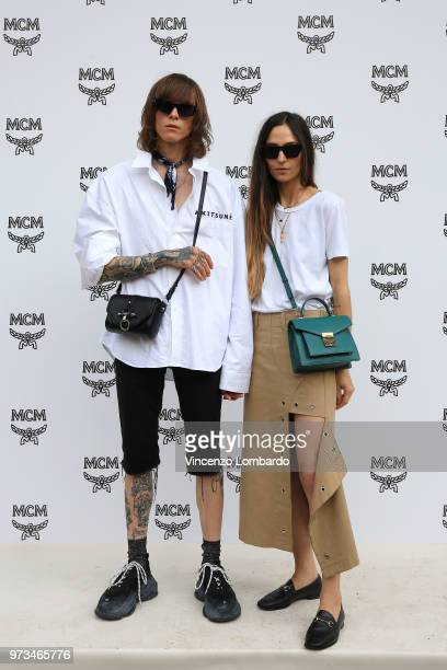 Simon Nygard and Ilenia Toma attend the MCM Fashion Show Spring/Summer 2019 during the 94th Pitti Immagine Uomo on June 13 2018 in Florence Italy