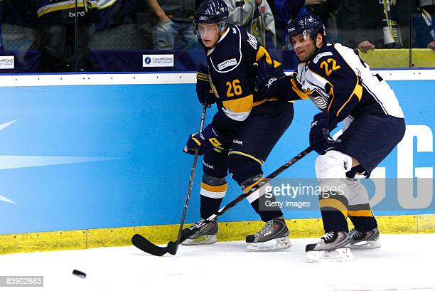 Simon Oenerud and Rami Alanko fights for the puck during the IIHF Champions Hockey League match between HV 71 Joenkoeping and Espoo Blues on December...