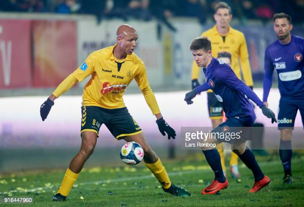 Simon Okosun of AC Horsens and Mads Dohr Thychosen of FC Midtjylland compete for the ball during the Danish Alka Superliga match between AC Horsens...