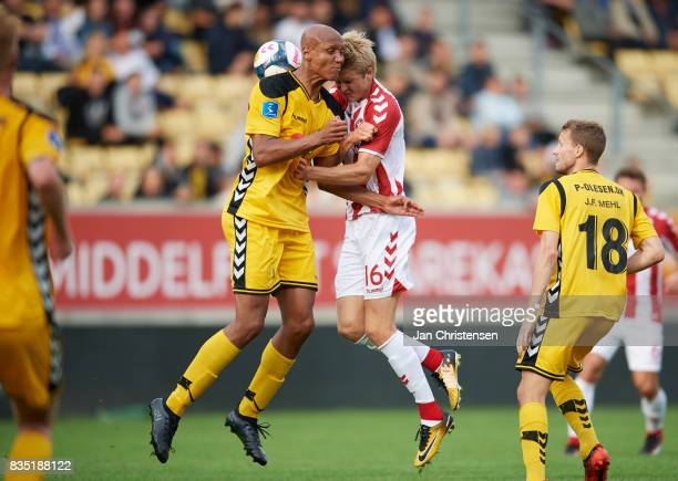 Simon Okosun of AC Horsens and Magnus Christensen of AaB Aalborg heading the ball during the Danish Alka Superliga match between AC Horsens and AaB...