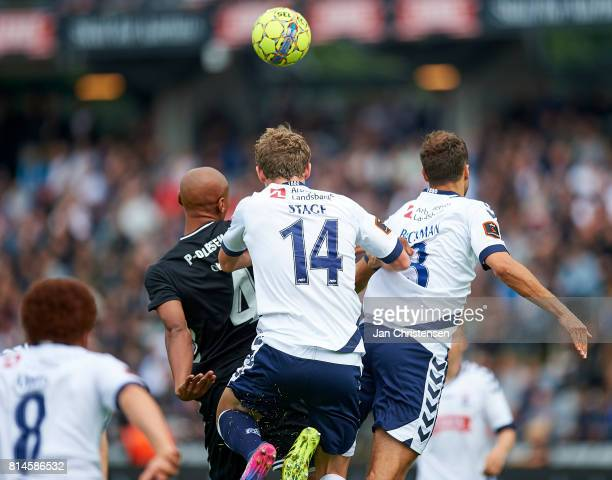 Simon Okosun of AC Horsens Jens Stage of AGF Arhus and Niklas Backman of AGF Arhus compete for the ball during the Danish Alka Superliga match...