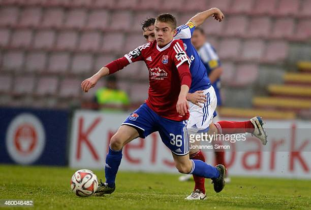 Simon Ollert of Unterhaching and Maik Kegel of Kiel fight for the ball during the Third League match between SpVgg Unterhaching and Holstein Kiel at...
