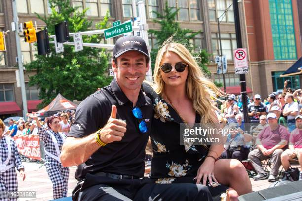Simon Pagenaud and girlfriend Hailey McDermott wave to the crowd during the 103rd Indy 500 Festival Parade on May 26 2019 in Indianapolis Indiana