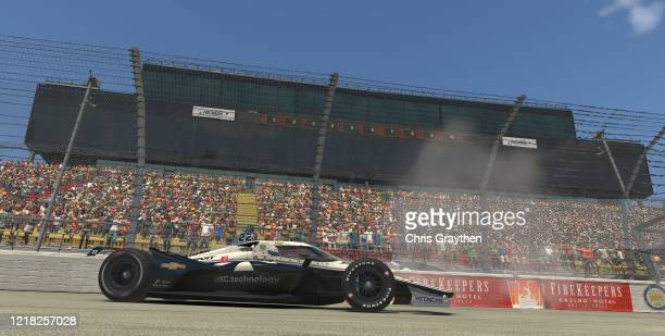 Simon Pagenaud, driver of the DXC Team Penske Chevrolet, celebrates after winning the IndyCar iRacing Challenge Chevrolet 275 at virtual Michigan...