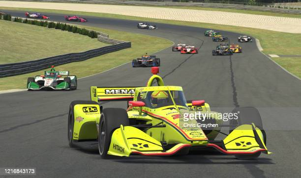 Simon Pagenaud driver of the Menards Team Penske Chevrolet races during the IndyCar iRacing Challenge Honda Indy Grand Prix of Alabama at virtual...