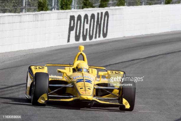 Simon Pagenaud driver of the Penske Truck Rental Team Penske Chevrolet races into turn 2 during the ABC Supply 500 on August 18 at Pocono Raceway in...