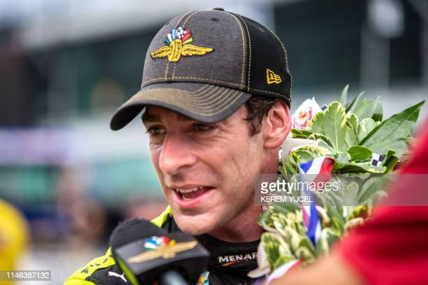 Simon Pagenaud of France driver of the Menards Team Penske Chevrolet celebrates after winning the 103rd running of the Indianapolis 500 at...