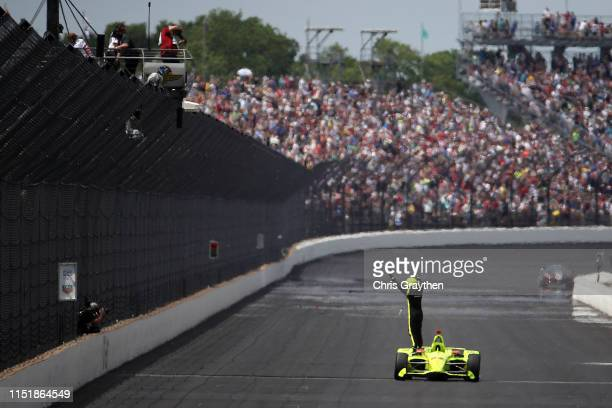 Simon Pagenaud of France, driver of the Menards Team Penske Chevrolet celebrates after winning the 103rd running of the Indianapolis 500 at...