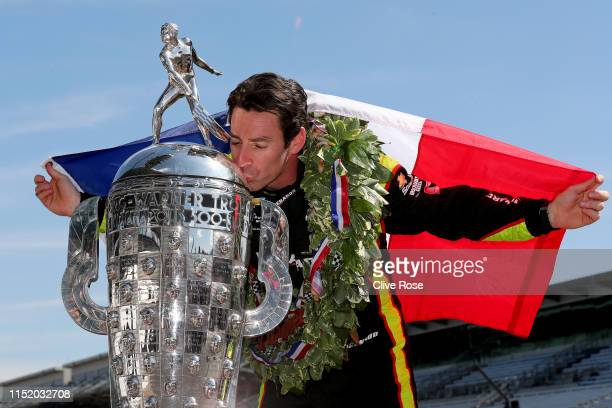 Simon Pagenaud of France driver of the Team Penske Chevrolet kisses BorgWarner Trophy during the Winner's Portraits session after the 103rd running...