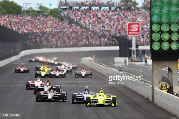 Simon Pagenaud of France, driver of the Team Penske Chevrolet leads the field away at the start of the 103rd Indianapolis 500 at Indianapolis Motor...