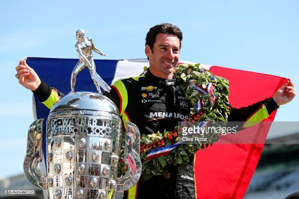 Simon Pagenaud of France driver of the Team Penske Chevrolet poses with the BorgWarner Trophy during the Winner's Portraits session after the 103rd...