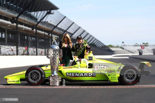 Simon Pagenaud of France driver of the Team Penske Chevrolet poses with his Wife Hailey McDermott during the Winner's Portraits session after the...