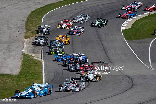 Simon Pagenaud, of France, leads the field through the first turn at the start of the Honda Indy Grand Prix of Alabama at Barber Motorsports Park on...